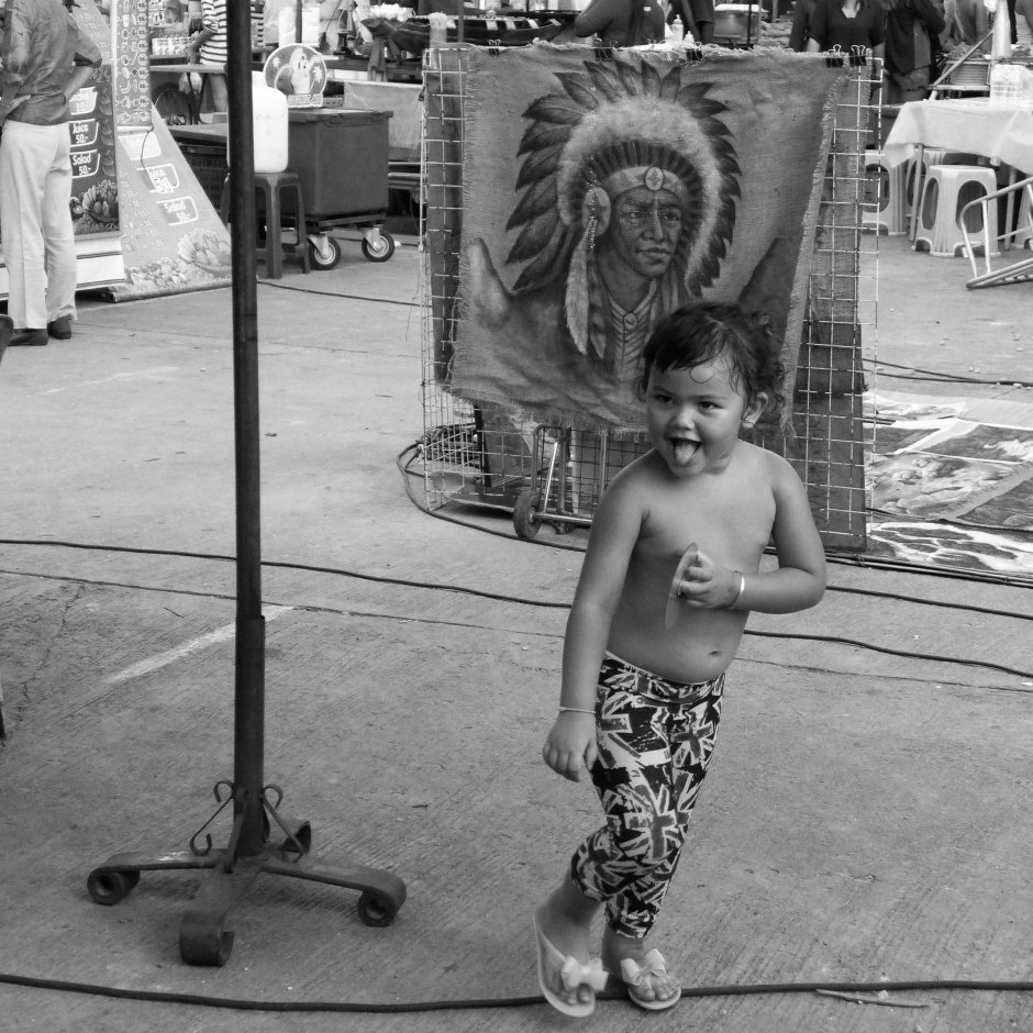 little girl skipping in the market