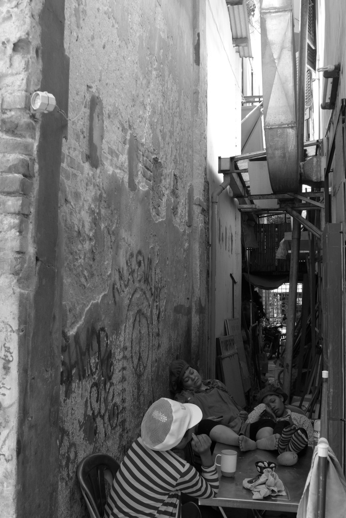 asleep in an alley